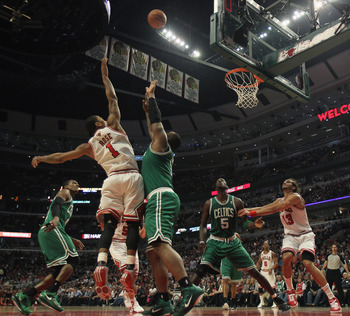 CHICAGO, IL - APRIL 07: Derrick Rose #1 of the Chicago Bulls puts up a shot over Glen Davis #11 of the Boston Celtics as Kevin Garnett #5 and Joakim Noah #13 set for a rebound at United Center on April 7, 2011 in Chicago, Illinois. The Bulls defeated the