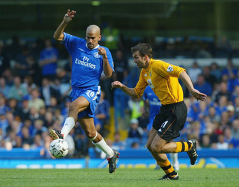 LONDON - AUGUST 30:  Juan Sebastien Veron of Chelsea battles with Marcus Babbel of Blackburn Rovers during the FA Barclaycard Premiership match between Chelsea and Blackburn Rovers at Stamford Bridge on August 30, 2003 in London. (Photo By Ben Radford/Get