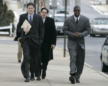 LEBANON - JANUARY 14: New York Giants wide receiver Plaxico Burress, right, walks with members of legal team as he arrives at the Lebanon County Courthouse January 14, 2009 in Lebanon, Pa.  Burress is scheduled to appear in a civil trial in a dispute with