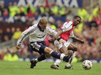 8 Apr 2001:  Sergei Rebrov of Tottenham Hotspur challenges Lauren of Arsenal during the AXA sponsored FA Cup Semi-Final match played at Old Trafford, in Manchester, England. Arsenal won the match 2-1. \ Mandatory Credit: Ross Kinnaird /Allsport