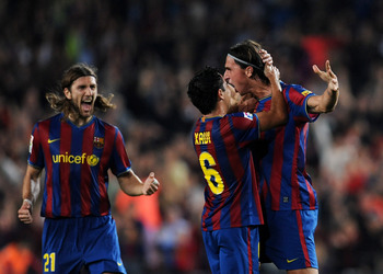 BARCELONA, SPAIN - OCTOBER 25:  Zlatan Ibrahimovic (R) of FC Barcelona celebrates scoring his side's second goal from a free kick with his teammates Xavier Hernandez (C) and Dmitro Chygrynskiy during the La Liga match between FC Barcelona and Real Zaragoz