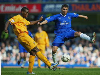 LONDON - APRIL 17:  Adrian Mutu of Chelsea closes down Joseph Yobo of Everton during the FA Barclaycard Premiership match between Chelsea and Everton at Stamford Bridge on April 17, 2004 in London.  (Photo by Ben Radford/Getty Images)
