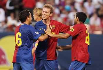 EAST RUTHERFORD, NJ - AUGUST 6: Aliaksandr Hleb #21(C) of the FC Barcelona celebrates his assist on Samuel Eto'o's #9 (not shown) goal in the 43rd minute against the New York Red Bulls at Giants Stadium August 6, 2008 in East Rutherford, New Jersey. Barce
