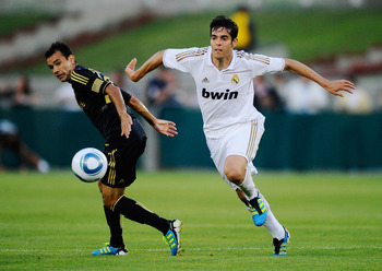 LOS ANGELES, CA - JULY 16:  Kaka #7 of Real Madrid pushes Juninho #19 of Los Angeles Galaxy during the Herbalife World Challenge 2011 friendly soccer game at Los Angeles Memorial Coliseum on July 16, 2011 in Los Angeles, California.  (Photo by Kevork Djan