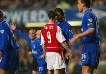 LONDON - MARCH 25:  Francis Jeffers of Arsenal goes head to head with Emmanuel Petit of Chelsea during the FA Cup Quarter Final Replay match between Chelsea and Arsenal at Stamford Bridge in London on March 25, 2003. (Photo By Ben Radford/Getty Images)