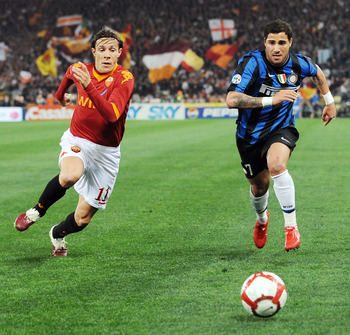 ROME - MARCH 27: Rodrigo Taddei of Roma  and Ricardo Quaresma  of Inter  in action during the Serie A match between AS Roma and FC Internazionale Milano at Stadio Olimpico on March 27, 2010 in Rome, Italy.  (Photo by Giuseppe Bellini/Getty Images)