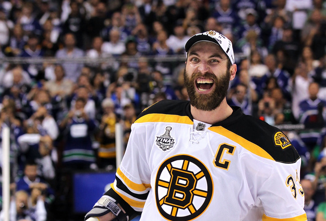 VANCOUVER, BC - JUNE 15:  Zdeno Chara #33 of the Boston Bruins celebrates with the Stanley Cup after defeating the Vancouver Canucks in Game Seven of the 2011 NHL Stanley Cup Final at Rogers Arena on June 15, 2011 in Vancouver, British Columbia, Canada. T