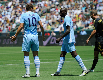 CARSON, CA - JULY 24:  Edin Dzeko #10 of Manchester City has words with teammate Mario Balotelli #45 after blasting the ball into the net he inexplicably tried to score with a spinning backheel which went wide of the target against the Los Angeles Galaxy