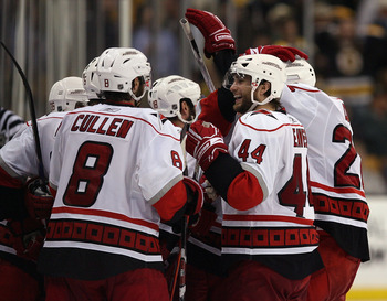 BOSTON - MAY 14:  Patrick Eaves #44 and Matt Cullen #8 of the Carolina Hurricanes celebrate the win over the Boston Bruins during Game Seven of the Eastern Conference Semifinal Round of the 2009 Stanley Cup Playoffs on May 14, 2009 at the TD Banknorth Gar