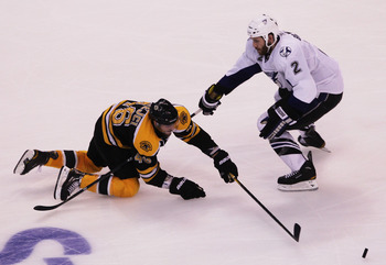 BOSTON, MA - MAY 27:  David Krejci #46 of the Boston Bruins and Eric Brewer #2 of the Tampa Bay Lightning vie for the puck in Game Seven of the Eastern Conference Finals during the 2011 NHL Stanley Cup Playoffs at TD Garden on May 27, 2011 in Boston, Mass