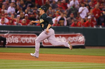 ANAHEIM, CA - MAY 23:  Cliff Pennington #2 of the Oakland Athletics runs to third base in the eighth inning during the game against the Los Angeles Angels of Anaheim at Angel Stadium on May 23, 2011 in Anaheim, California.  (Photo by Joe Scarnici/Getty Im
