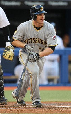 TORONTO, CANADA - JUNE 29:  Lyle Overbay #37 of the Pittsburgh Pirates drills a base hit against the Toronto Blue Jays in an MLB interleague game on June 29, 2011 at the Rogers Centre in Toronto, Canada. (Photo by Claus Andersen/Getty Images)