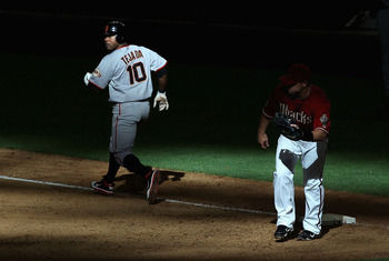 PHOENIX, AZ - APRIL 17:  Miguel Tejada #10 of the San Francisco Giants runs past first base after a force out from infielder Russell Branyan #33 of the Arizona Diamondbacks during the Major League Baseball game at Chase Field on April 17, 2011 in Phoenix,