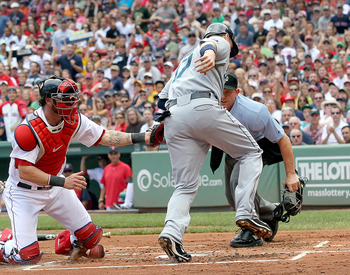 BOSTON, MA  - JULY 24: Jarrod Saltalamacchia #39 of the Boston Red Sox tags out Justin Smoak #17 of the Seattle Mariners at the plate at Fenway Park on July 24, 2011 in Boston, Massachusetts.  (Photo by Jim Rogash/Getty Images)