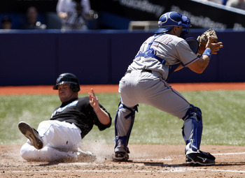 TORONTO - MAY 16: Aaron Hill #2 of the Toronto Blue Jays slides home safe past Matt Treanor #15 of the Texas Rangers during a MLB game at the Rogers Centre May 16, 2010 in Toronto, Ontario, Canada. (Photo by Abelimages/Getty Images)
