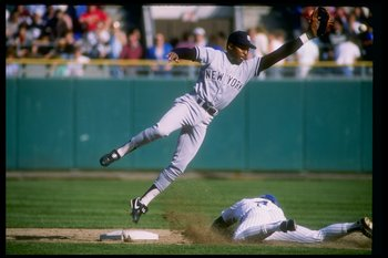 Infielder Willie Randolph of the New York Yankees (left) in action during a game.