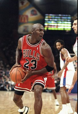 17 Oct 1997: Guard Michael Jordan of the Chicago Bulls in action with the ball during a McDonald''s Championship game against PSG Racing at the Palais Omnisports de Paris-Bercy in Paris, France. The Bulls won the game 89-82.