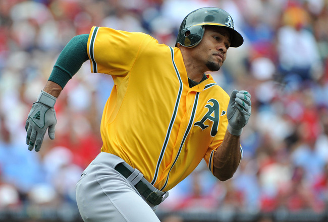 PHILADELPHIA - JUNE 26: Coco Crisp #4 of the Oakland Athletics rounds first base after hitting a double in the top of the first inning against the Philadelphia Phillies at Citizens Bank Park on June 26, 2011 in Philadelphia, Pennsylvania. (Photo by Christ