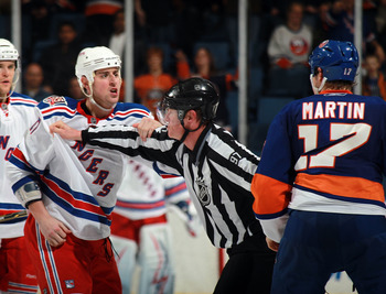 UNIONDALE, NY - MARCH 31: Matt Martin #17 of the New York Islanders and Brandon Dubinsky #17 of the New York Rangers chat at the Nassau Coliseum on March 31, 2011 in Uniondale, New York.  (Photo by Bruce Bennett/Getty Images)