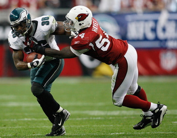 GLENDALE, AZ - JANUARY 18:  Running back Brian Westbrook #36 of the Philadelphia Eagles is tackled by linebacker Gerald Hayes #54 of the Arizona Cardinals during the NFC championship game on January 18, 2009 at University of Phoenix Stadium in Glendale, A