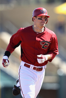 SCOTTSDALE, AZ - MARCH 09:  Collin Cowgill #70 of the Arizona Diamondbacks rounds the bases after a home run during the spring training game against the Milwaukee Brewers at Salt River Fields at Talking Stick on March 9, 2011 in Scottsdale, Arizona.  (Pho
