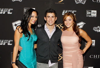 LAS VEGAS - FEBRUARY 15:  Kendra Perez (L) UFC fighter Dominick Cruz and UFC Octogon Girl Brittney Palmer arrive at UFC, Famous Stars and Straps and New Era's 'The Magic Party' at XS the nightclub on February 15, 2011 in Las Vegas, Nevada.  (Photo by Isaa