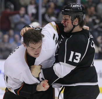 LOS ANGELES, CA - APRIL 09:  Kyle Clifford #13 of the Los Angeles Kings throws a punch at Sheldon Brookbank #21 of the Anaheim Ducks in the third period at Staples Center on April 9, 2011 in Los Angeles, California. The Ducks defeated the Kings 3-1.  (Pho
