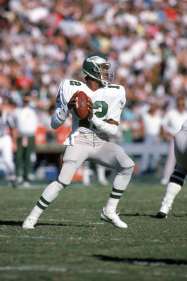 LOS ANGELES - NOVEMBER 30:  Quarterback Randall Cunningham #12 of the Philadelphia Eagles looks to pass during a game against the Los Angeles Raiders at the Los Angeles Memorial Coliseum November 30, 1986 in Los Angles, California.  The Eagles won 33-27 i