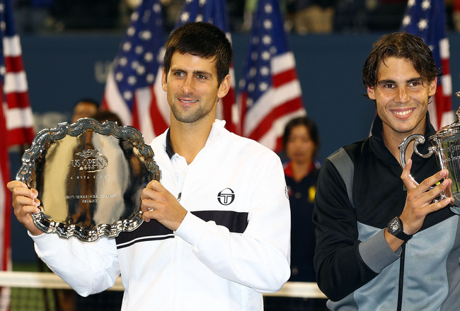 NEW YORK - SEPTEMBER 13:  Rafael Nadal of Spain (2nd R) poses with the championship trophy alongside runner up Novak Djokovic of Serbia (L) and USTA President Lucy Garvin (2nd L) after their men's singles final on day fifteen of the 2010 U.S. Open at the