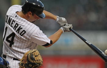CHICAGO, IL - MAY 17: Paul Konerko #14 of the Chicago White Sox hits the ball against the Texas Rangers at U.S. Cellular Field on May 17, 2011 in Chicago, Illinois. The White Sox defeated the Rangers 4-3. (Photo by Jonathan Daniel/Getty Images)