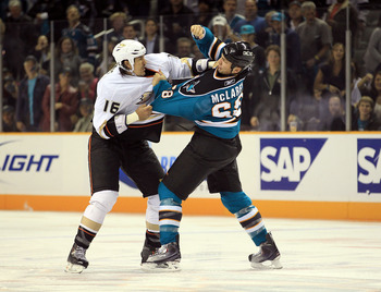 SAN JOSE, CA - NOVEMBER 09:  George Parros #16 of the Anaheim Ducks fights with Frazer McLaren #68 of the San Jose Sharks at HP Pavilion on November 9, 2010 in San Jose, California.  (Photo by Ezra Shaw/Getty Images)