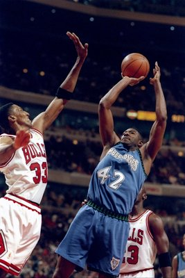11 Dec 1996:  Forward Sam Mitchell of the Minnesota Timberwolves (right) goes up for two as Chicago Bulls guard Scottie Pippen covers him during a game at the United Center in Chicago, Illinois.  The Bulls won the game, 103-86. Mandatory Credit: Jonathan