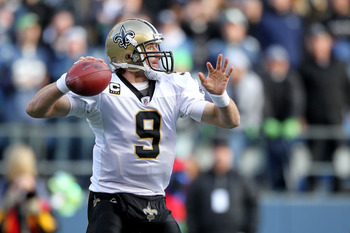SEATTLE, WA - JANUARY 08:  Quarterback Drew Brees #9 of the New Orleans Saints throws the ball against the Seattle Seahawks during the 2011 NFC wild-card playoff game at Qwest Field on January 8, 2011 in Seattle, Washington.  (Photo by Otto Greule Jr/Gett