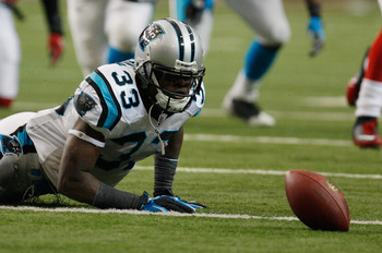 ATLANTA, GA - JANUARY 02:  Mike Goodson#33 of the Carolina Panthers loses a fumble in the second quarter during their game against the Atlanta Falcons at the Georgia Dome on January 2, 2011 in Atlanta, Georgia.  (Photo by Scott Halleran/Getty Images)