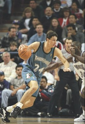 19 Dec 1996:  Forward Tom Gugliotta of the Minnesota Timberwolves tries to drive past forward Michael Smith of the Sacramento Kings at the Arco Arena in Sacramento, California.  The Kings won the game 112-105.   Mandatory Credit: Otto Greule  /Allsport