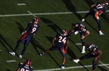 DENVER - DECEMBER 26:  Brady Quinn #9, Daniel Coats #85, Champ Bailey #24, Tim Tebow #15, Marcus Thomas #79, and Britt Davis #17 of the Denver Broncos take the field to warm up prior to facing the Houston Texas at INVESCO Field at Mile High on December 26