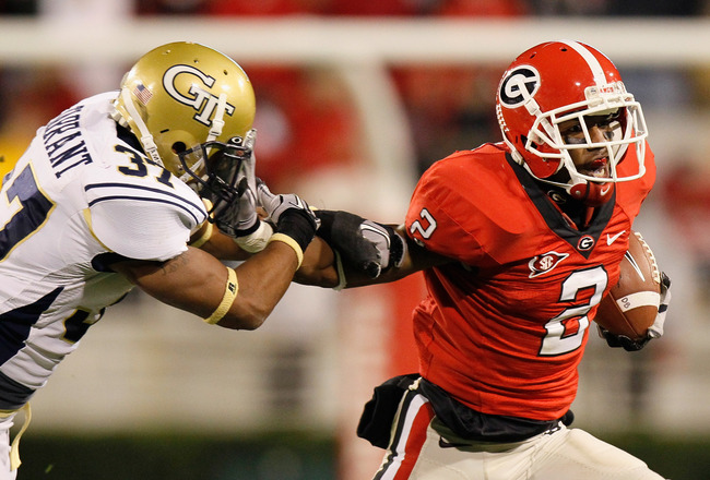 ATHENS, GA - NOVEMBER 27:  Brandon Boykin #2 of the Georgia Bulldogs stiff arms Jerrard Tarrant #37 of the Georgia Tech Yellow Jackets on a return at Sanford Stadium on November 27, 2010 in Athens, Georgia.  (Photo by Kevin C. Cox/Getty Images)