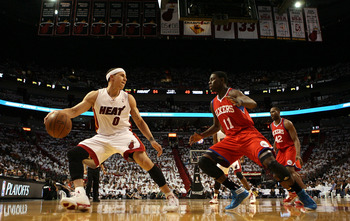 MIAMI, FL - APRIL 16:  Guard Jrue Holiday #11 of the Philadelphia 76ers defends against guard Mike Bibby #0 of the Maim Heat at the American Airlines Arena in Game One of the Eastern Conference Quarterfinals in the 2011 NBA Playoffs on April 16, 2011 in M