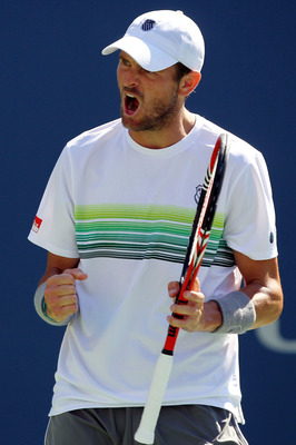 NEW YORK - SEPTEMBER 06:  Mardy Fish of the United States reacts after breaking Novak Djokovic of Serbia during the men's singles match on day eight of the 2010 U.S. Open at the USTA Billie Jean King National Tennis Center on September 6, 2010 in the Flus