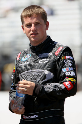 LOUDON, NH - JULY 16:  Justin Allgaier, driver of the #31 Wolfpack Rentals Chevrolet, stands on the grid during qualifying for the NASCAR Nationwide Series New England 200 at New Hampshire Motor Speedway on July 16, 2011 in Loudon, New Hampshire.  (Photo