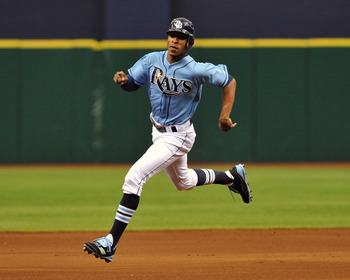 ST. PETERSBURG, FL - JULY 3:  Outfielder B. J. Upton #2 of the Tampa Bay Rays runs to third base against the St. Louis Cardinals July 3, 2011 at Tropicana Field in St. Petersburg, Florida.  (Photo by Al Messerschmidt/Getty Images)