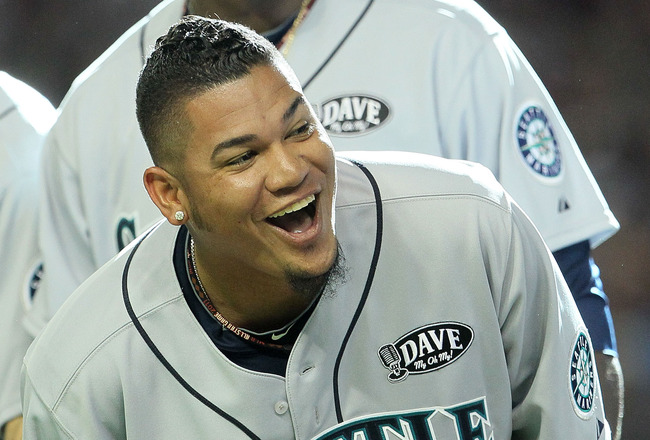 PHOENIX, AZ - JULY 12:  American League All-Star Felix Hernandez #34 of the Seattle Mariners and American League All-Star Michael Pineda #36 of the Seattle Mariners react during player introductions before the start of the 82nd MLB All-Star Game at Chase