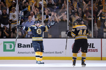 BOSTON, MA - JUNE 08:  Brad Marchand #63 of the Boston Bruins celebrates with his teammate Dennis Seidenberg #44 after scoring a goal in the second period against Roberto Luongo #1 of the Vancouver Canucks during Game Four of the 2011 NHL Stanley Cup Fina