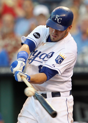 KANSAS CITY, MO - JULY 23:  Mike Moustakas #8 of the Kansas City Royals connects during the game against the Tampa Bay Rays on July 23, 2011 at Kauffman Stadium in Kansas City, Missouri.  (Photo by Jamie Squire/Getty Images)