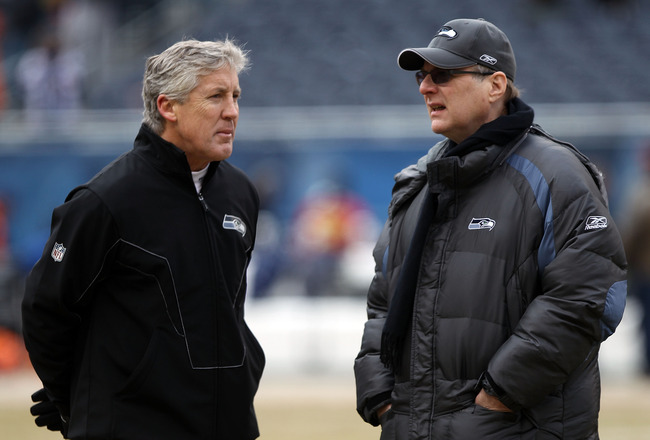 CHICAGO, IL - JANUARY 16:  (L-R) Head coach Pete Carroll of the Seattle Seahawks talks with Seahawks team owner Paul Allen before the 2011 NFC divisional playoff game against the Chicago Bears at Soldier Field on January 16, 2011 in Chicago, Illinois.  (P