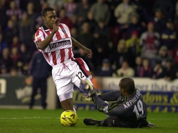 29 Nov 2000:  Kyle Lightbourne of Stoke gets past Pegguy Arphexad of Liverpool during the Worthington Cup tie between Stoke City v Liverpool at the Brittania Stadium, Stoke on Trent.  Digital Image.  Mandatory Credit: Ross Kinnaird/ALLSPORT