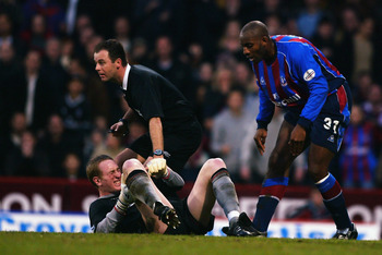 LONDON - JANUARY 26:  Chris Kirkland of Liverpool holds his leg as he sustains a injury after colliding with Dele Adebola of Crystal Palace during the FA Cup fourth round match held on January 26, 2003 at Selhurst Park, in London. The match ended in a 0-0