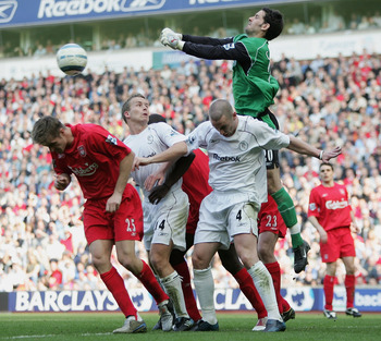 LIVERPOOL, ENGLAND - APRIL 2: Scott Carson, the Liverpool goalkeeper, punches clear from Kevin Nolan and Kevin Davies of Bolton during the Barclays Premiership match between Liverpool and Bolton Wanderers at Anfield on April 2, 2005 in Liverpool, England