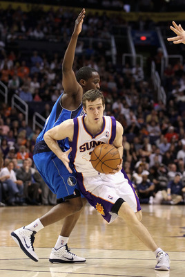 PHOENIX, AZ - FEBRUARY 17:  Goran Dragic #2 of the Phoenix Suns drives the ball past Rodrigue Beaubois #3 of the Dallas Mavericks during the NBA game at US Airways Center on February 17, 2011 in Phoenix, Arizona.  NOTE TO USER: User expressly acknowledges