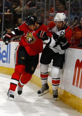 OTTAWA, ON - JANUARY 3:  Filip Kuba #17 of the Ottawa Senators throws a bodycheck on Mike Richards #18 of the Philadelphia Flyers in a game at Scotiabank Place on January 3, 2010 in Ottawa, Canada.  (Photo by Phillip MacCallum/Getty Images)